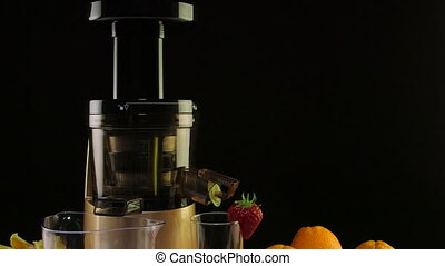 Dolly: Cold press juicer for making fruit and berry juice from strawberry and orange