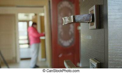 Dolly: Customer chooses new door in the doors store showroom