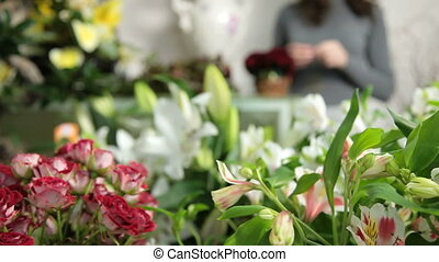 DOLLY: Florist Arranging Bouquet