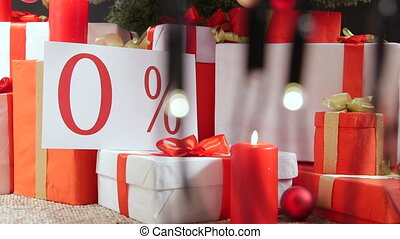 Dolly: Gift boxes with zero percent sign under Christmas...