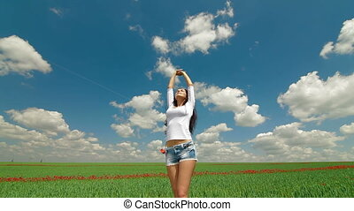 DOLLY: Happy Young Woman In A Field
