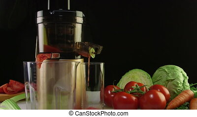 Dolly: Making fresh vegetable juice from tomato using masticating juicer machine