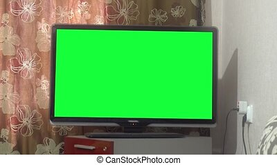 Dolly Move Into a Big Screen TV With Greenscreen.