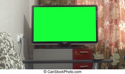 Dolly Move Into a Big Screen TV With Greenscreen