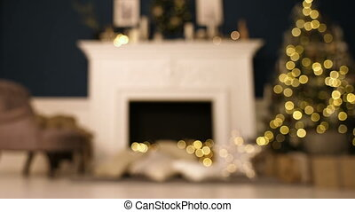 Christmas home room with tree and festive bokeh lighting, blurred holiday background.