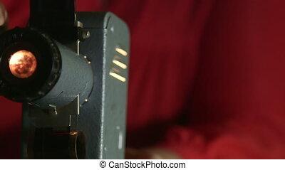 DOLLY: Retro Filmstrip Projector - Senior woman looking...