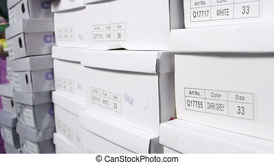 Dolly: Row of shoes boxes stacked in  shoe store