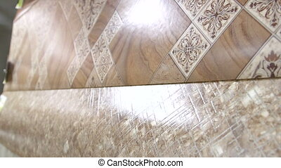 Dolly: Samples of linoleum in flooring warehouse showroom