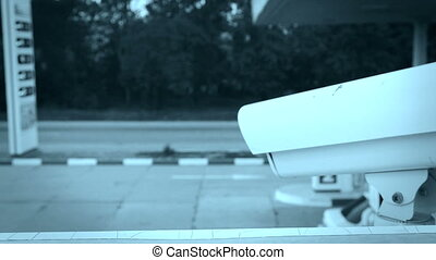 DOLLY: Security Camera - Security camera of retail gas...