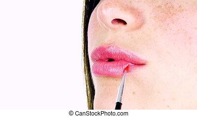closeup of lips getting makeup