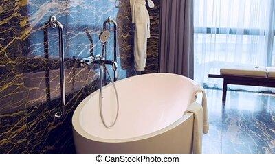 Dolly shot of big hotel bathroom
