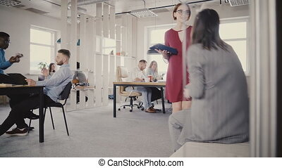 Dolly shot of casual multiethnic millennial people enjoying...
