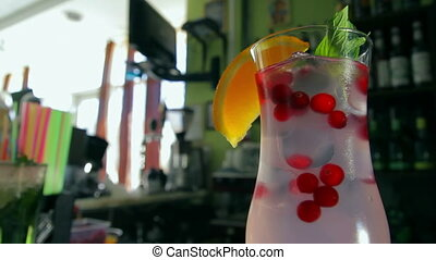 Dolly shot of cranberry cocktail