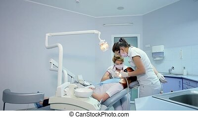 Dolly Shot of Dentist Examining Oral Cavity of a Patient with Toothache