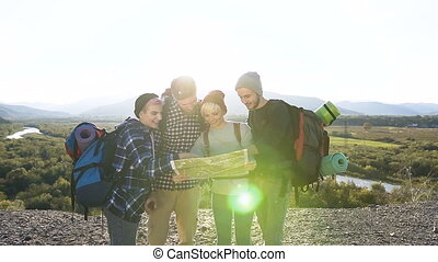 Dolly shot of four happy friends during hike in the mountains.