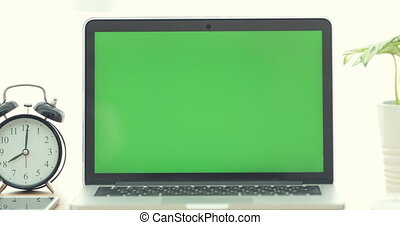 Dolly shot of Laptop computer with green screen.