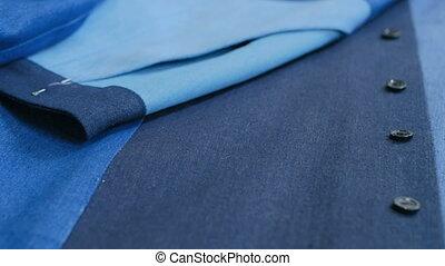 Dolly shot of smart business women's suit jacket - denim,...