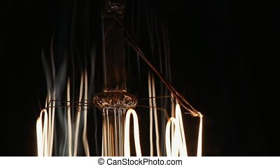 Dolly slide of glowing edison lamp