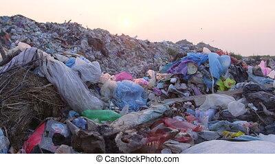 DOLLY: Urban Refuse Dump At Sunset