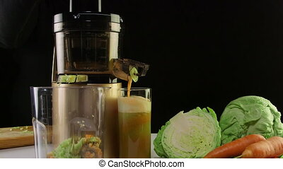 Dolly: Vegetable juice making process using cold press juicer from carrot and cabbage