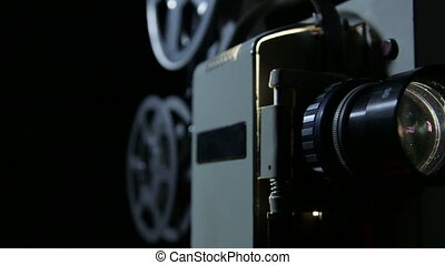 Dolly: Vintage movie projector in action