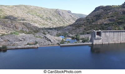 Dolly zoom out of broken dam - Aerial dolly zoom out of...