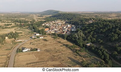 Dolly zoom over old small village near hills - Castilla,...