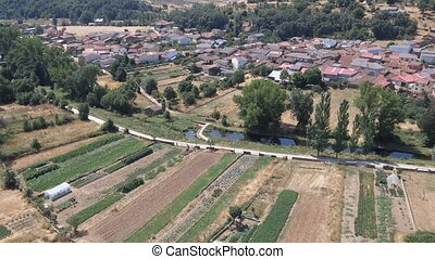 Dolly zoom over old small village near river - Castilla,...