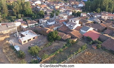 Dolly zoom over old small village roofs - Castilla, dolly...