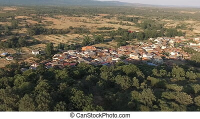 Dolly zoom over old small village with tile roofs -...