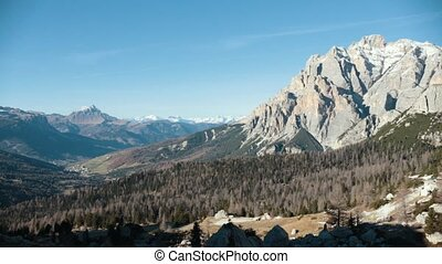 Dolomites. Beautiful overview of mountains and a forest....