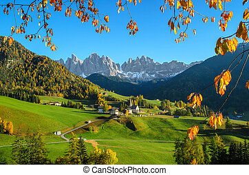 The mountain village and church of St. Magdalena (Santa Maddalena) in the Villnösstal (Val di Funes) in South Tyrol in Italy with in the background the Geisler (Odle) dolomites mountain group.