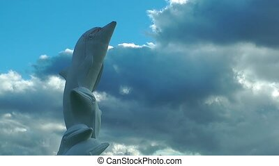 Dolphin Statue and Clouds time laps