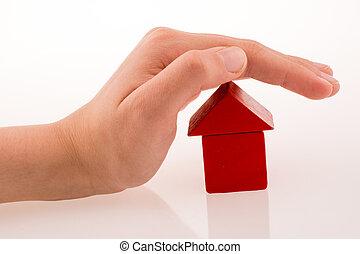 dom, kostki, ręka