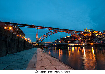 Dom Luis I Bridge illuminated at night. Oporto, Portugal  wester