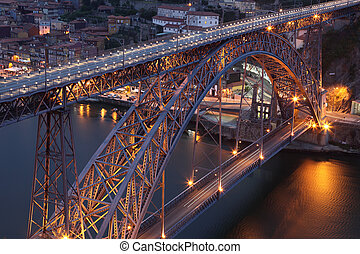 Dom Luis Iron Bridge in Porto illuminated at dusk, Portugal
