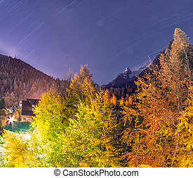 Dombai. Night city between the rockies in Caucasus region in...