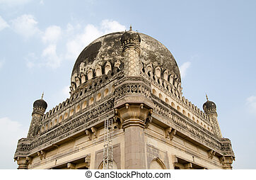 Detail of a dome at the Qutb Shahi Tombs complex in Golconda, Hyderabad, India. Built during the Mughal Empire, the tombs hold the mausoleums of the ruling Sultans of the area.