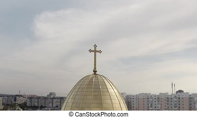 Dome of church, aerial view, traditional old church in city Lviv, Ukraine, cloudy sky background