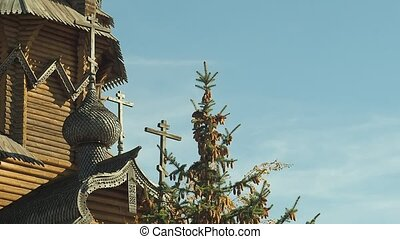 Dome of monastery with crosses and wooden decorative...