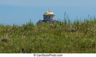 Dome of the Church in Grass - The dome of the Christian...