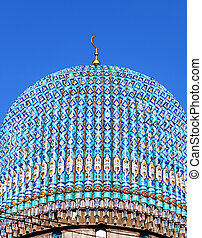 Dome of the St. Petersburg Cathedral Mosque against blue sky