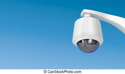 Dome security camera against blue sky