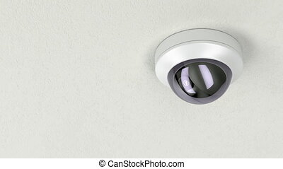 Dome security camera attached on white ceiling