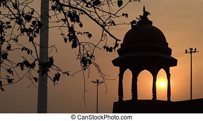 Dome tower in India at sunset - Wide shot of a dome over an ...