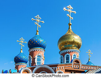 Domes of Russian orthodox church against the blue sky