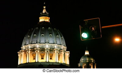 Domes St. Peters Basilica and traffic lights in Rome