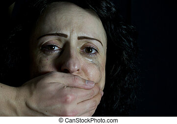 domestic abuse - crying woman being silenced, not speaking...