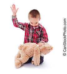Domestic Abuse - Angry little kid beating his teddy bear -...