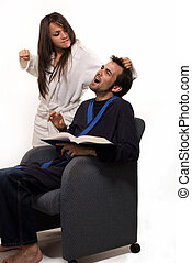 Domestic abuse - Young man wearing bathrobe sitting in a...